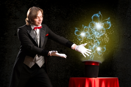 magician makes passes at the cylinder, the cylinder produces magic photo