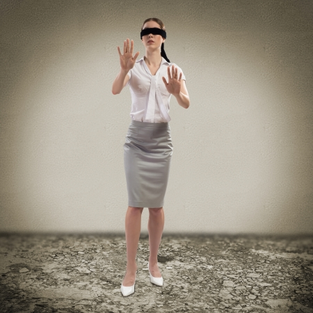 young blindfolded woman  can not find a way out photo