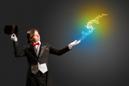 from the hand of the magician produces multicolored smoke photo