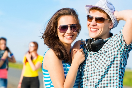 young couple standing on the road, having fun with friends Stock Photo - 20678288