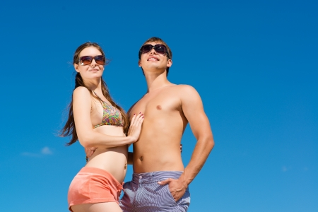 Young couple hugging on a background of blue sky Stock Photo - 20678222