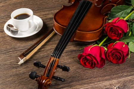 music instruments: Violin, rose, cup of coffee and music books, still life Stock Photo