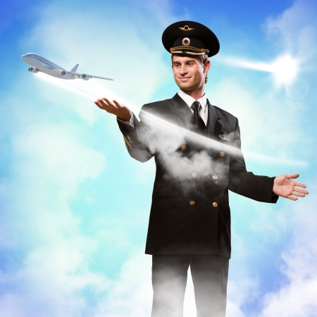 extending: pilot in the form of extending a hand to a flying airplane on the background of clouds and sun