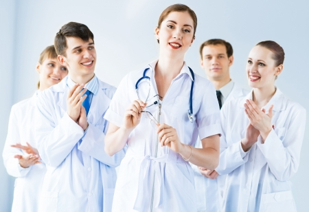 accepts: successful doctor, accepts congratulations from colleagues, stand behind him and clap Stock Photo