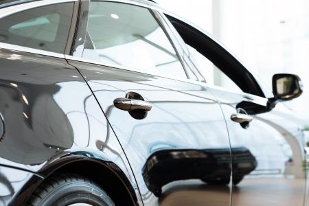 Modern expensive black car in the showroom photo