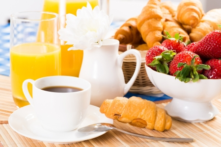 traditionally french: continental breakfast  coffee, strawberry, croissant and juice