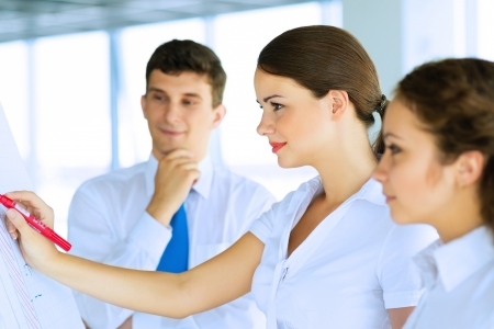 business consultant discussing with colleagues around the flipchart, teamwork Stock Photo - 21354596