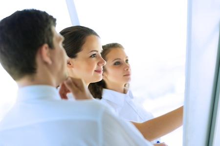 business consultant discussing with colleagues around the flipchart, teamwork Stock Photo - 21467844