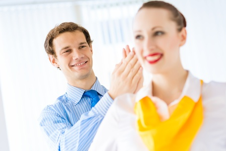 businessman applauding his colleague, the success of teamwork photo