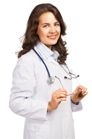 woman doctor holding glasses and smiling, isolated on white background photo