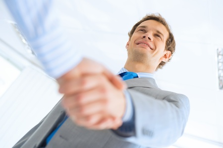Young Businessman Shaking Hands With A Colleague An Agreement Stock