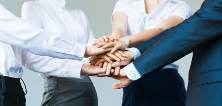 concept of teamwork  business people joined hands