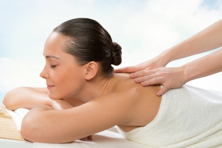 beautiful spa woman lying on a couch, female hands massaged Stock Photo - 21894232