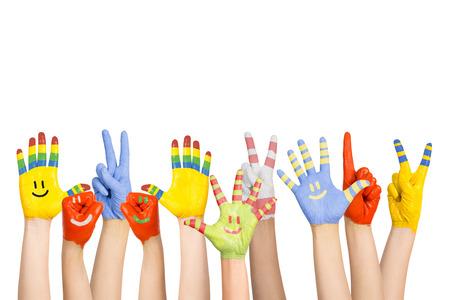 Manos de los niños pintados s en diferentes colores con emoticones Foto de archivo - 22220382