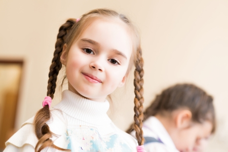 portrait of a girl in an apron, the kids involved in art school photo