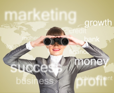 business woman looking through binoculars, concept search solutions in business photo