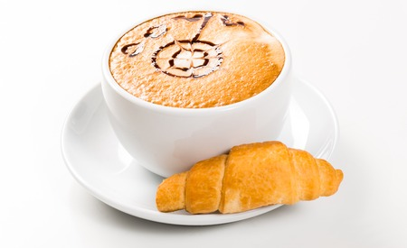 large cup of coffee with a pattern on foams and croissants, an early breakfast photo