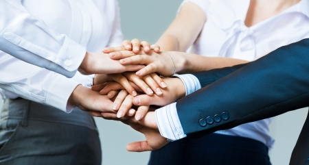 people working together: concept of teamwork  business people joined hands