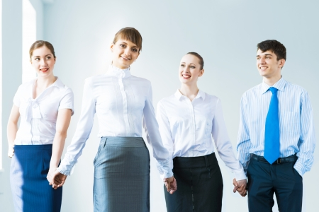 leadership team, a group of business people standing in a number of hand-in-hand, the leader stepped forward