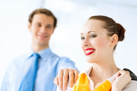 young successful business woman smiling, a colleague put his hand on her shoulder Stock Photo - 22767976