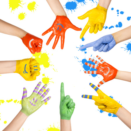 painted children s hands in different colors with smilies