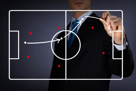 감독의 이미지는 축구 게임의 그림을 그립니다