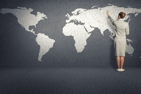 business woman draw a map on the wall, a global business Stock Photo - 22996709