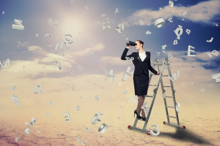 climbed: businesswoman climbed a ladder and looking through binoculars