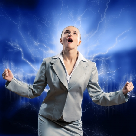 furious woman is straining arms and looking up, concept violent person photo