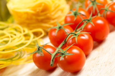 close-up of cherry tomatoes and pasta, still life photo