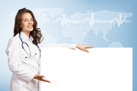 Young attractive female doctor put her hand on the blank banner, place for text photo