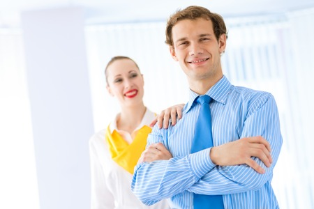 Businessman receiving congratulations from his colleagues in the leadership team work Stock Photo