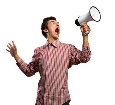 aloft: Portrait of a young man shouting using megaphone, isolated on white Stock Photo