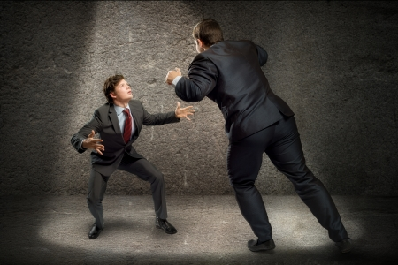 contestation: two businessmen fighting as sumoists, the concept of competition in business