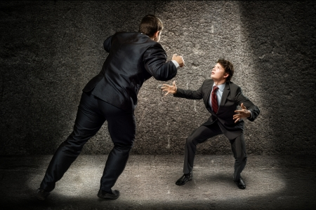 two businessmen fighting as sumoists, the concept of competition in business photo