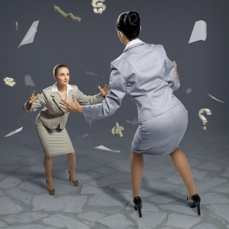 businesspartners: two businesswomen fighting as sumoists, the concept of competition in business