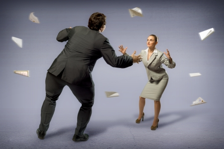 businesspartners: two businessmen fighting as sumoists, the concept of competition in business