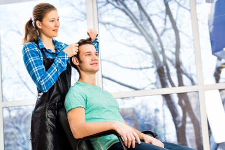 young attractive woman hairdresser hairstyle customer picks photo