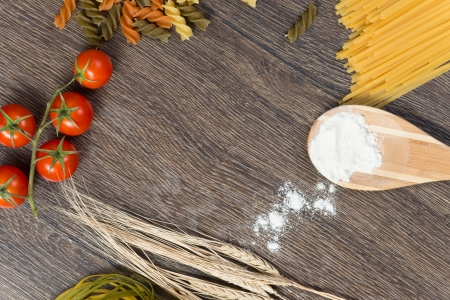 food ingredients and spices on wooden table photo
