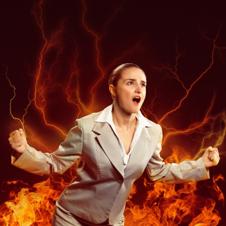 furious woman is straining arms and looking up, concept violent person Stock Photo - 24684127