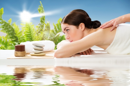 beautiful spa woman lying on a couch, female hands massaged Stock Photo - 24737282