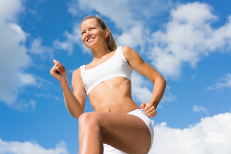 likes: Young sports woman likes to run, view from below