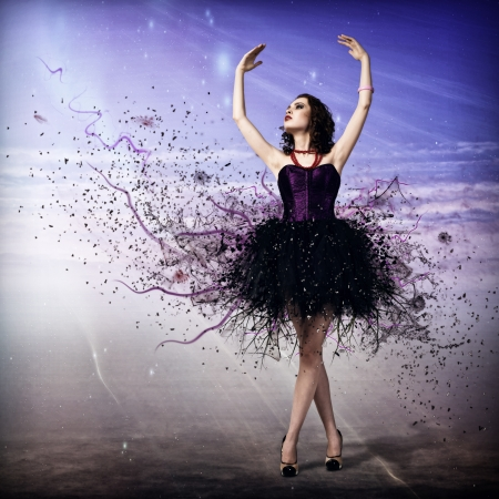 Young woman dancing for her abstract background photo