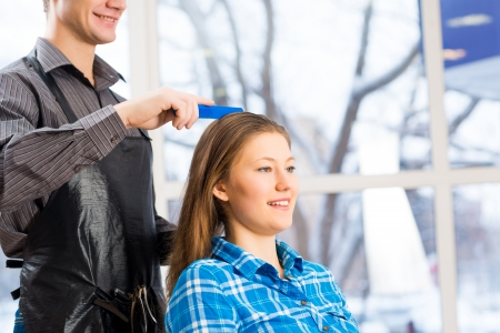 male hairdresser puts woman s hair in a hairdressing salon Stock Photo - 24839790