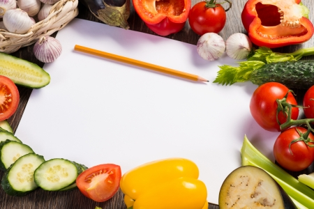 Vegetables tiled around a sheet of paper and a pencil  space for text Stok Fotoğraf