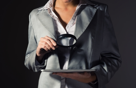business woman looking for a problem in the plate, the concept of information security photo