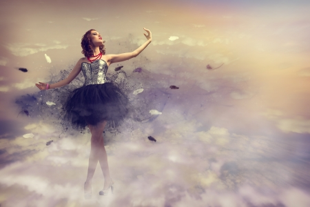 woman dancing in a dress made of smoke and feathers photo