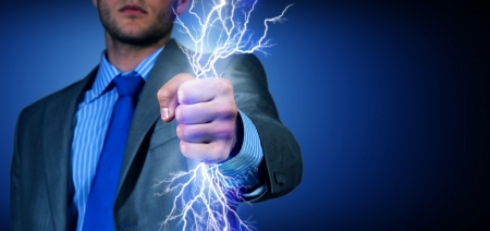 determinism: close-up of clasped hand, hand of lightning flashes and lights