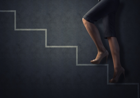 business woman legs drawn up the stairs, concept of success in business photo
