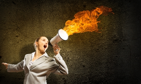 business woman cooks shouting into a megaphone, megaphone fire photo